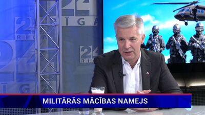 Aizsardzības ministrs par uzņemto video ar sievieti un raudošu bērnu militāro mācību laikā Rīgā