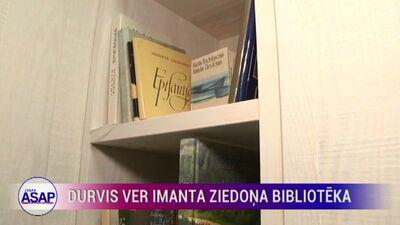 Durvis ver Imanta Ziedoņa bibliotēka